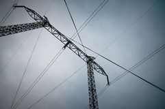Transmission Line. Pylon and transmission power line. Electricity pylons with distribution power station blue cloudy sky backgroun Stock Image