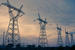 Pylon and transmission power line in sunset Stock Photos