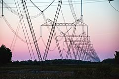 Pylon and transmission power line. In sunset stock photos