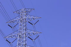 Pylon workers. Electric power transmission, Electricity pylon and workers Stock Photo