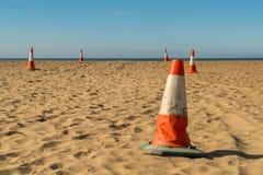 Pyloner på stranden Arkivfoton