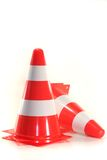 Pylons. Red and white construction pylons before a white background Royalty Free Stock Photo