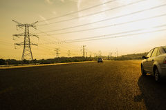 Pylons along asphalted highway in sunny summer afternoon Royalty Free Stock Photography