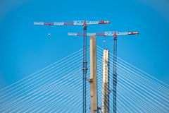 Pylons and bridge cranes Royalty Free Stock Photos