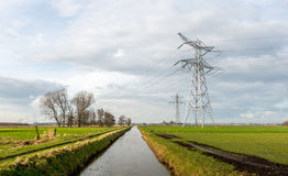 Pylons and cables from a high voltage grid in a rural area Stock Image