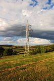 Pylons in countryside Royalty Free Stock Photos