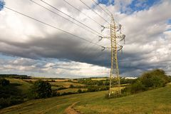 Pylons in countryside. Pylons in the landscape with clouds Royalty Free Stock Images