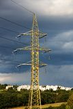Pylons in countryside Stock Images