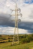 Pylons in countryside Stock Image