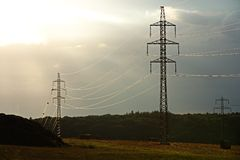 Pylons in countryside Stock Photo