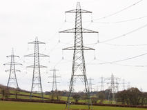 Pylons dominant in the countryside Stock Photography
