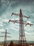 Pylons. Electric pylons in a country scene Royalty Free Stock Photography