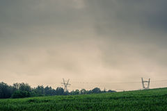 Pylons on a green field Royalty Free Stock Image