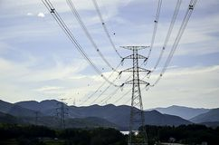 Pylons of the high voltage electric cables in the mountain Royalty Free Stock Images