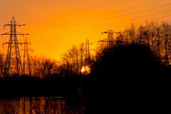 Pylons By Lake At Sunset Stock Image