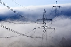 Pylons in the mist Royalty Free Stock Photo