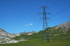 Pylons in Mountains. Electricity pylons crossing the Bernese Alps. These cables transport electricity from the major hydro-electric generating areas in the high Stock Image