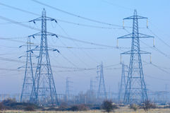 Pylons of Power. Pylons dotted over the countryside Stock Photo
