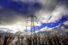 Pylons. Pylon electric electricity power generation cable cables metal steel industry industrial industries national grid fossil fuel fuels network national grid Royalty Free Stock Images