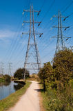 Pylons by the river. Basking in the sunshine Stock Photo