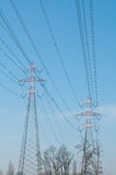 Pylons of steel that are used to carry electrical current silhou Royalty Free Stock Photography