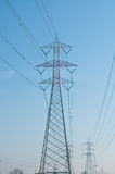 Pylons of steel that are used to carry electrical current silhou Royalty Free Stock Image