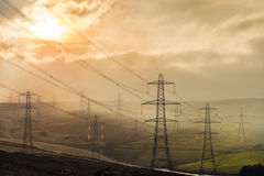Pylons at sunset Royalty Free Stock Photography