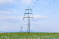 Pylons in winterly landscape Stock Image
