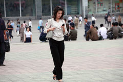 Pyongyang female with mobile phone royalty free stock photos