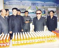 North Korean Supreme Leader Kim Jong-un with comrades. Pyongyang, North-Korea - November 13, 2011: Scan of an official photography of North-Korean leader Kim royalty free stock photography