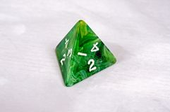 Pyramic shaped dice. Stock Image