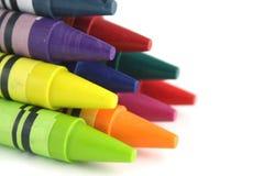 Pyramid of 10 crayons. Random crayons focus on the front crayon Stock Photos