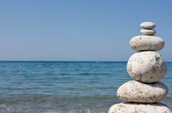 Pyramid. Zen stone pyramid with sea background stock photos