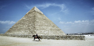 Pyramid. Horseman riding alongside Keops pyramid Stock Photography