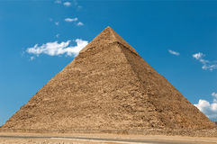 Pyramid. Of Cheops against the cloudy sky stock images