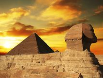 Pyramid. Egyptian sphinx and pyramid on sunset Royalty Free Stock Images