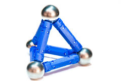 Pyramid. From dark blue shelves and balls on a white background Royalty Free Stock Images