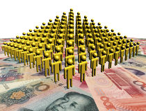 Pyramid of abstract people on Chinese Yuan Royalty Free Stock Photography