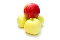 Pyramid of Apples. Red Apple over Three Yellow Apples Isolated on White Background Stock Photo