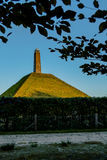 Pyramid of Austerlitz seen trough leaves vertical. Pyramid of Austerlitz seen trough leaves. This dutch pyramid is built in the French period Stock Photos