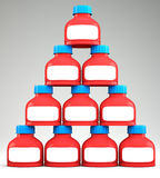 Pyramid of blank plastic containers. On grey background. 3d illustration Royalty Free Stock Photo