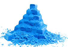 Pyramid from blue chalk. Pyramid from blue crushed chalk on white Royalty Free Stock Image