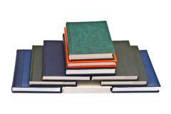 Pyramid of books. Isolated on white background royalty free stock image