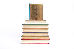 A pyramid from books with color covers stock photos