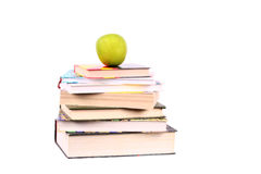 Pyramid of books green apple on the top stock photos