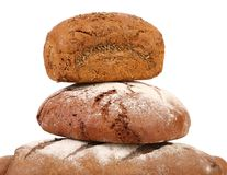 Pyramid of brown breads. Stock Photos