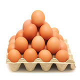 Pyramid of brown eggs Stock Images