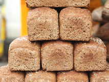 Pyramid of brown wheat-rye bread. At czech farmers market Stock Image