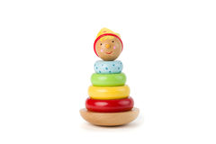 Pyramid build from colored wooden rings with a king head on top. Toy for babies and toddlers to joyfully learn mechanical skills a Stock Photos
