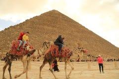 pyramid and camel rider Stock Photos